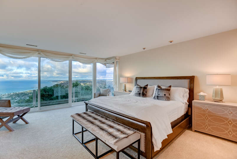 A king size bed welcomes you to the master suite and its magnificent view