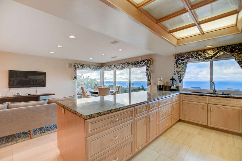 The kitchen is open to the family room and the TV