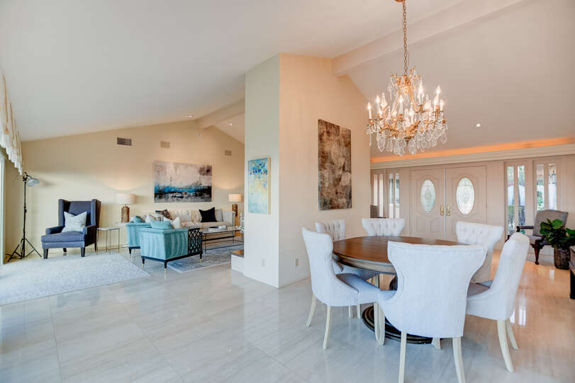 The dining area and living room form separate, yet open spaces with the fireplace
