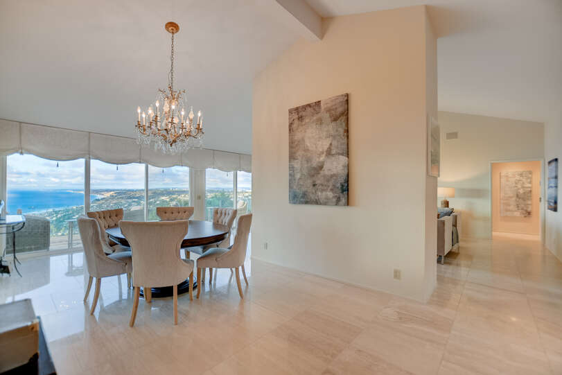 The dining area and its chandelier welcome you inside.