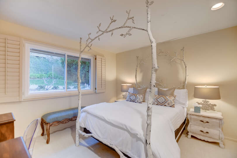 Bedroom two has a delightfully whimsical queen size bed