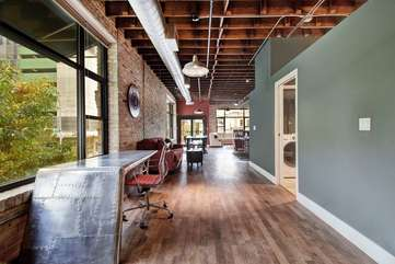 Brazos Loft | WorkspaceHallway leading from bedroom to living space