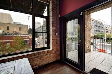 Brazos Loft | Dining Room + Balcony