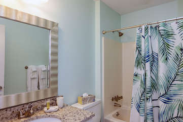 Full hall bath with skylight shared between second and third bedrooms.