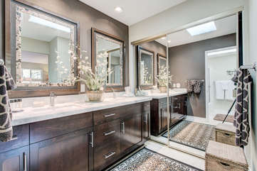 Master bathroom with full mirrored closets