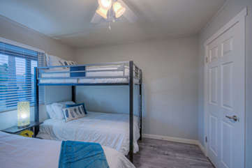 The fourth bedroom has a queen bed plus bunk beds