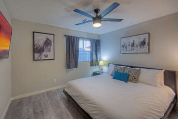 Second bedroom is spacious and has a king bed and large TV
