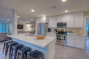 Remodeled kitchen with stainless steel appliances will appeal to the chef and helpers