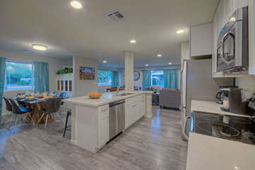 An open style trendy kitchen keeps everyone included in the fun