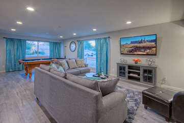 Trendy contemporary style creates desirable ambiance in the spacious and cozy great room