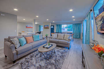 Great room has comfortable seating for enjoying the large television with your favorite people