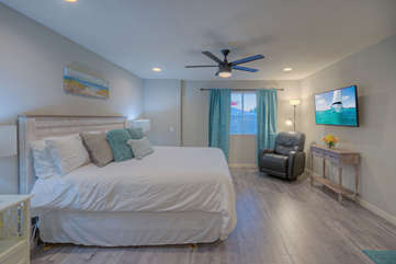 Guests will enjoy the space and comfort in the master bedroom