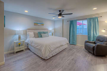 Dream of exciting Arizona adventures in pretty master bedroom with large windows