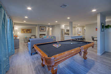 Aim for the pocket of your choice and enjoy friendly competition with home's impressive pool table