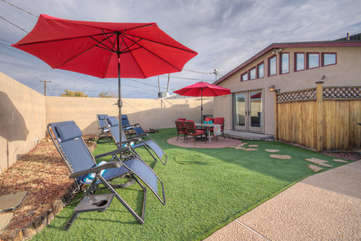 Relax in new outdoor lounge chairs with umbrellas for the shade loving guests