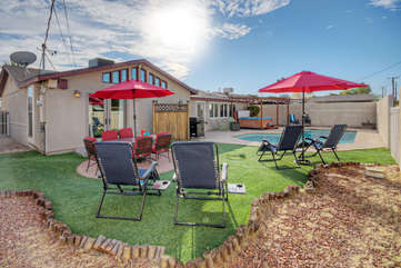 Private backyard invites you to recline poolside with your favorite peeps