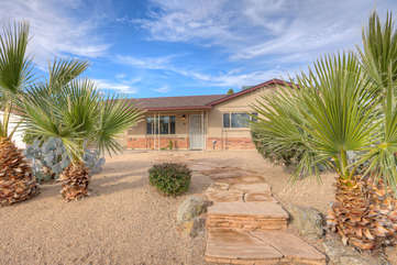 Hidden from view are exciting backyard amenities in appealing Tempe home