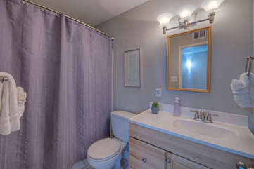 The second bathroom has a tub-shower combination and is shared by second and third bedrooms