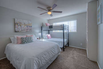The third bedroom has a queen bed, 2 bunk beds and a ceiling fan