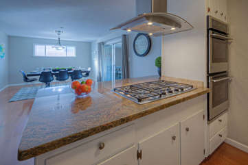 Newly updated kitchen has stainless steel appliances and granite counter tops