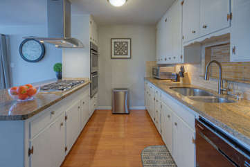 Kitchen is designed to be highly functional and has plentiful work space for prepping and serving meals
