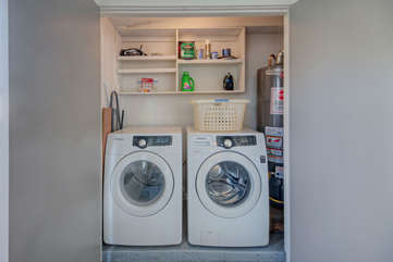 Enclosed and stocked laundry area allows you to complete all laundry tasks at home