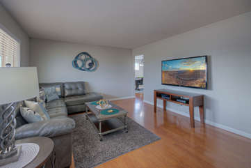Great room has cozy and comfy seating for watching the large television