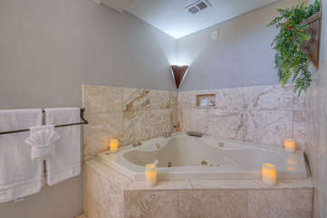 Step into this luxurious jetted garden tub for a tranquil soak after an invigorating day on the golf course or trail riding at Papago Park