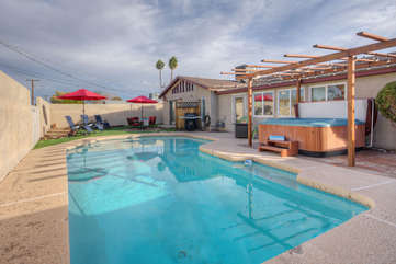 Treat yourself to a memorable vacation in remodeled Tempe home with exciting amenities that include a pool, hot tub and propane grill