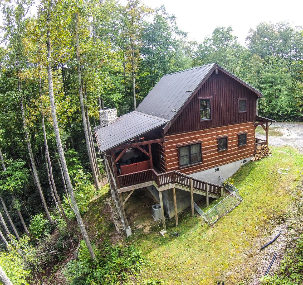 Rustic log cabin in the clouds