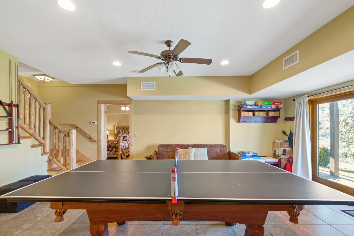 Lower level game room with ping pong/pool table