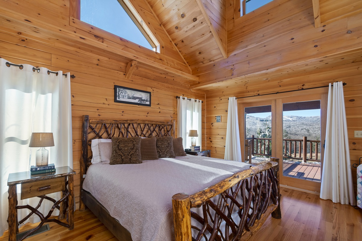 Master bedroom with king bed and full bath