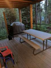 Big Bear has a grill and picnic table perfect for those summer barbecues.