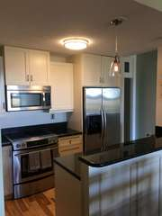 Updated kitchen with granite counters and stainless appliances