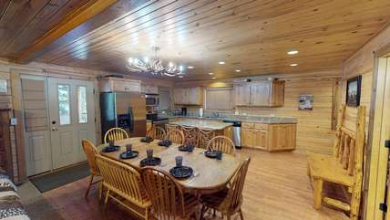 This cabin provides a dining table to gather round and enjoy your favorite meal together.