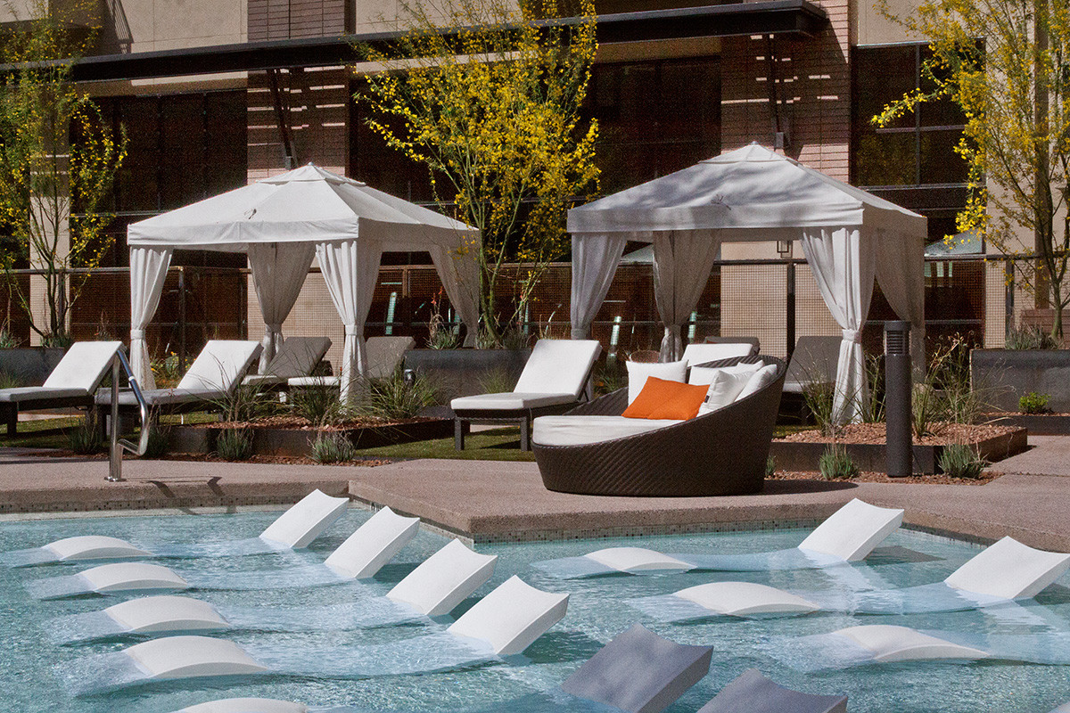 In pool lounge chairs (daytime photo)