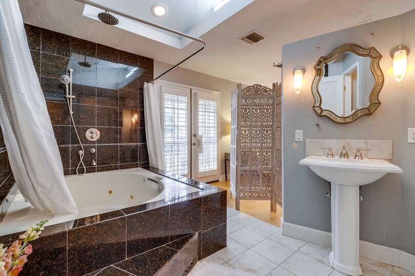 Multiple shower heads and a jetted tub turn the master bath into a spa retreat
