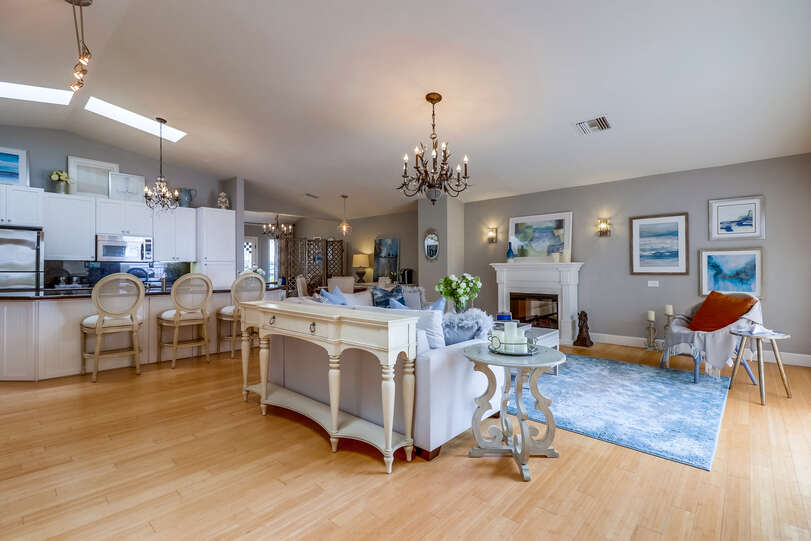 The great room welcomes you to this charming home with light and elegance