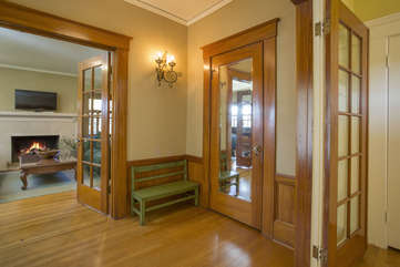 French doors off the large entry lead to the sitting room and living room