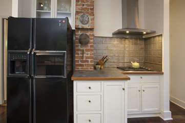 Check out the cool metal backsplash and countertop!