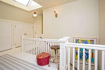 Skylight, white paint, and storage on spacious upstairs landing
