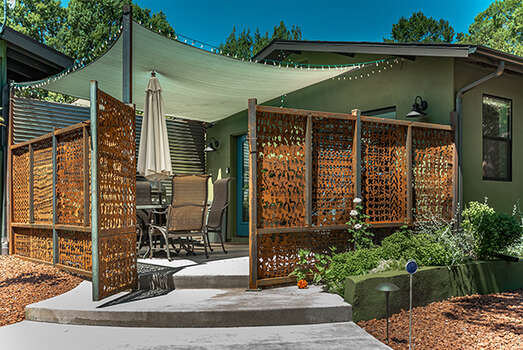 Entry into the Luxury Casita with a Quaint and Shaded Outdoor Space, and Driveway Parking