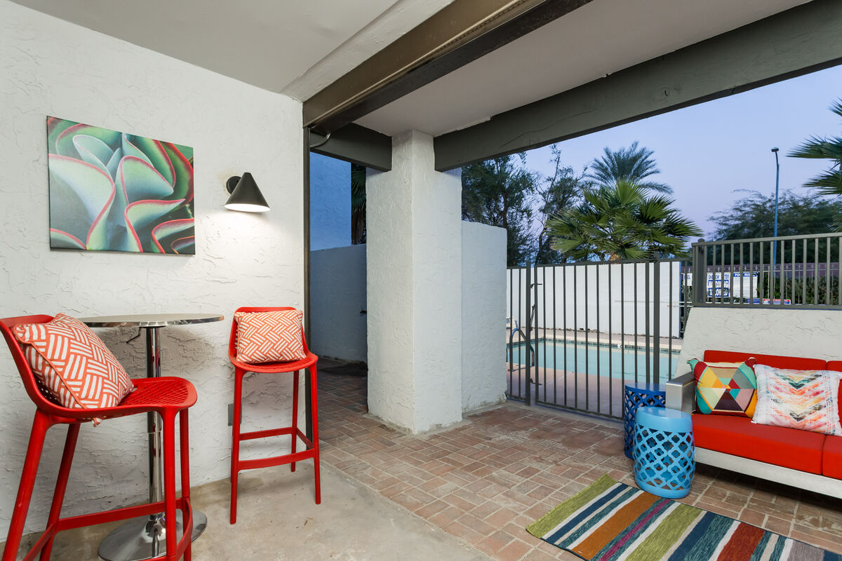 Walk out to the pool from our patio. Comfortable patio sofa & loveseat w/ bistro table and chairs.