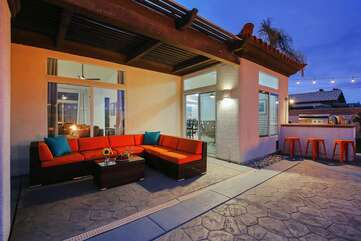 4 sets of sliding glass doors provide easy access to the pool from  living room, kitchen and master bedroom
