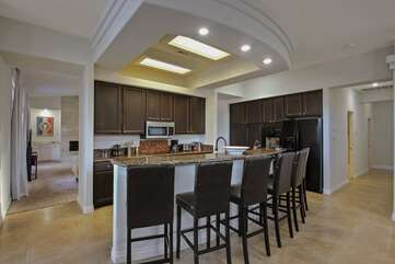 Convenient kitchen bar area. Top end appliances and all the cookware you need to prepare and serve your meals