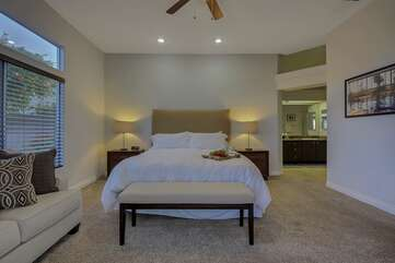 The master bedroom is large enough for a sofa sleeper to sleep a total of 4