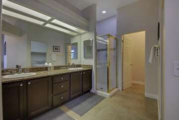 Master bathroom has dual sinks,  private shower, separate bathroom and a huge walk in closet with a twin sized bed in there (*this bed is for overflow guests and is not in advertized bed count)