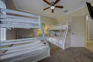 Bedroom 3, Two bunk beds. Each sleeps two on bottom, 1 on top to sleep a total of 6 in this bedroom.  TV