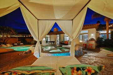 This huge Vegas style cabana by the spa and firepit is a favorite spot among repeat guests