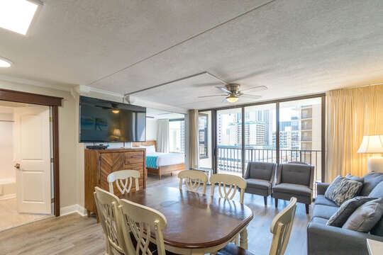 View of full condo with sitting areas and bedroom that can be separated by sliding doors